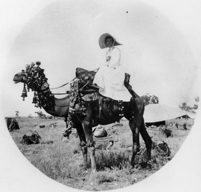 StateLibQld_1_166831_Unidentified_woman_on_a_camel,_ca._1880